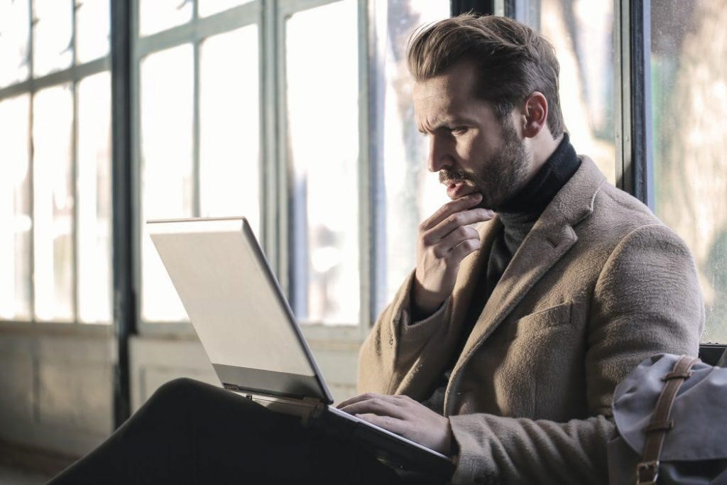 Man taking an online questionnaire